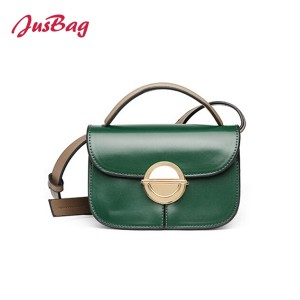 Crossbody clutch bag with circle buckle